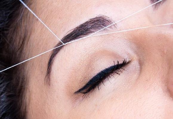 depilazione sopracciglia con filo orientale
